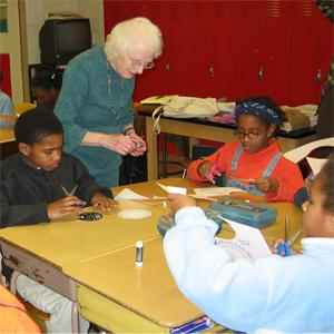 Nancy Grace Roman teaches astronomy to 5th graders at Shepherd Elementary School in Washington, DC, in the late 1990s.